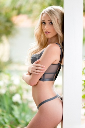 Beautiful blonde girl Riley Anne strips off her lingerie in the garden