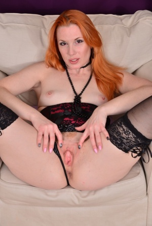 Flaming redhead Michelle Russo toys her snatch in stockings upon a chair 54516012
