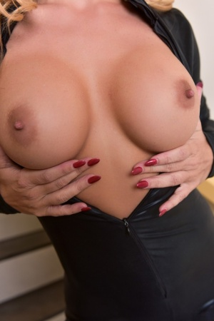 Hot blonde chick Cherie DeVille frees her yummy body from a black bodysuit