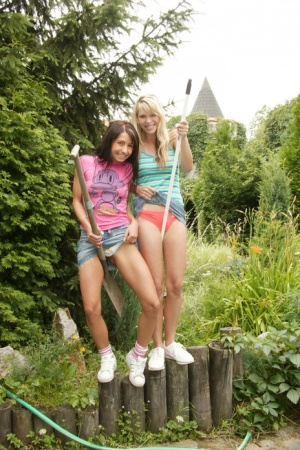 Two kinky college girls get dirty while cleaning the garden