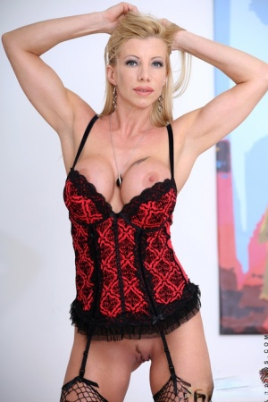 Tall blonde Lara De Santis looses firm tits from a corset before a finger fuck