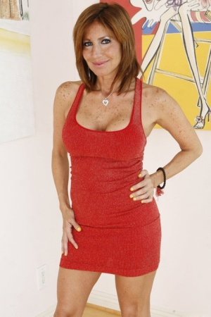 Stepmom in a red dress introduces her stepdaughter to the joy of lesbian sex