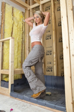 Amateur model Nikki Sims slips off cargo pants to pose in thong and work boots