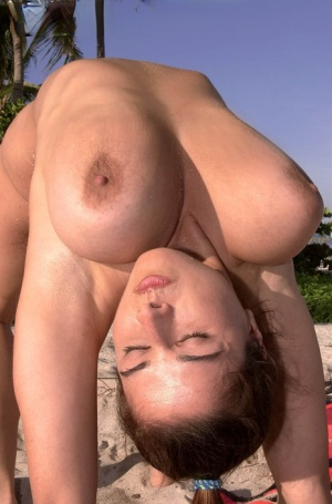 Super busty Chloe Vevrier letting her massive big tits hang loose at the beach