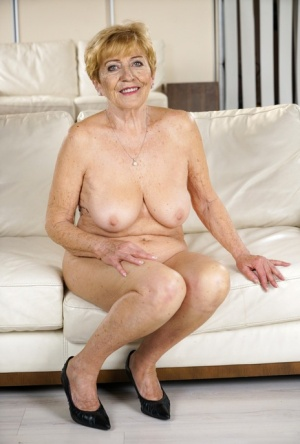 Older granny Malya kissing her boy toy before riding  getting a cum facial
