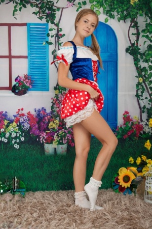 Cosplay cutie Flower sheds her costume to pose nude on her knees in socks