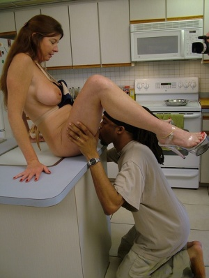 Mature housewife Dee Delmar gets herself some big black cock in the kitchen 80579277