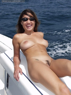 Amateur model with big naturals takes off her bikini aboard a yacht
