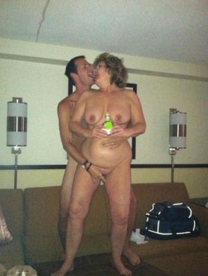 Horny granny BustyBliss oils up floppy tits  spreads pussy for hotel boy toy