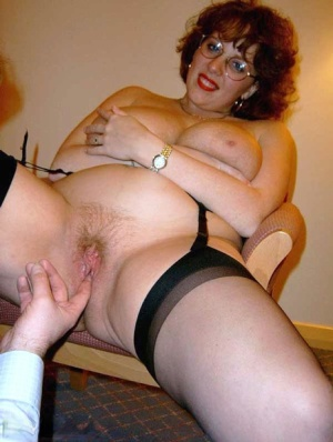 Big titted mature woman Curvy Claire wears her glasses while swapping oral sex