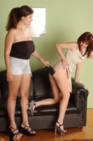 British amateur Denise Davies takes a lesbian over her knee on a loveseat