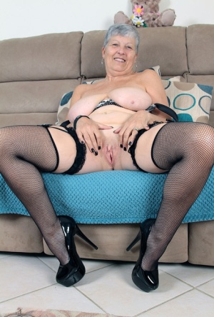 Old woman Savana takes off hat prior to revealing her large saggy breasts