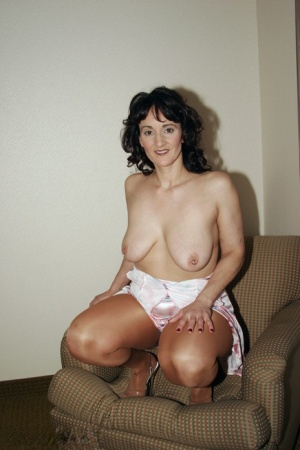 Horny mature Reba unveils her saggy tits  spreads wide open in tan stockings