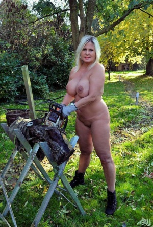 Thick blonde serves beer with big boobs out after putting in wood in the nude