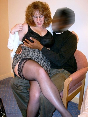 British redhead Curvy Claire has her big naturals played with by a black man