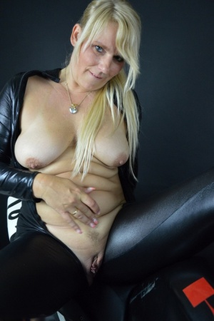 Blonde amateur Sweet Susi unzips a cat suit to expose her tits and snatch