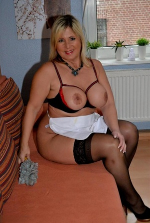Thick mature MILF Nude Chrissy does her housework in cupless bra and stockings