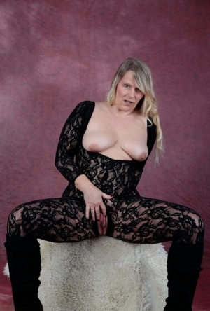 Blonde amateur Sweet Susi removes a bodystocking to pose nude in leg warmers
