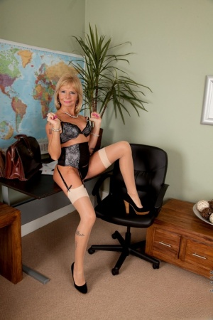 Hot older businesswoman Cathy Oakely shows her bald twat in FF nylons
