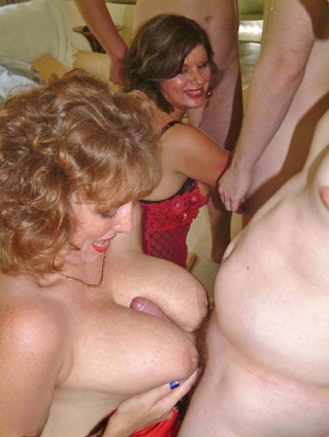 Mature women wear lingerie and hosiery while getting gangbanged together