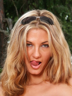 Sexy blonde Vanessa parts her pussy lips after touting her big naturals