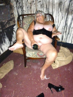 Old woman Grandma Libby sticks an empty bottle of booze in her vagina