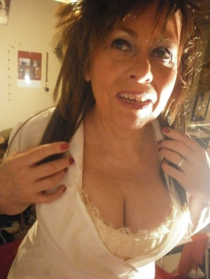 Mature lady Caro gest decked out in naughty nurse attire for a live cam show 24086684