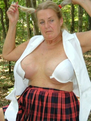 Blonde nan Adonna heads into the woods for nude poses in schoolgirl attire 25103484