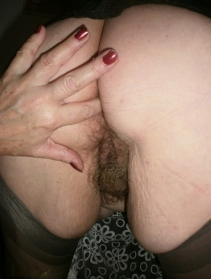Kinky amateur mature woman Caro reveals and pleases her wolf hairy twat 36889998