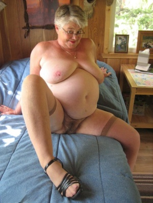Short haired granny Girdle Goddess stripping to her stockings and high heels 66241253