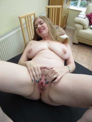 Chubby mature mom Lily May offers big saggy tits  spreads her bald pussy lips