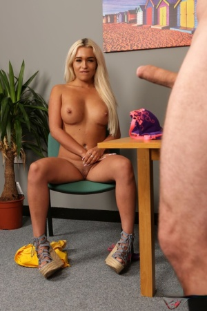 Blonde female Lillie Mae gets totally naked while watching a man jerk off