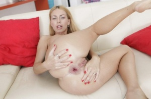 Blonde solo girl Isabella Clark toys her prolapsed asshole with a huge dildo