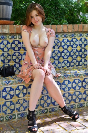 Pretty natural redhead Aria-II undressing outdoors to flaunt her nice big tits 24995373
