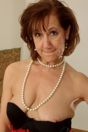 Classy mature lady uncovers her saggy tits as she readies to showcase her twat