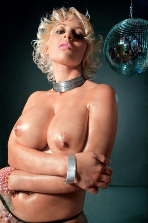 Sex slave Flor wears her blonde hair in curls during a double penetration