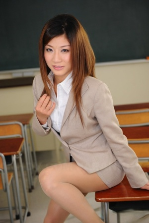 Japanese business executive Yayoi shows her pretty face while fully clothed