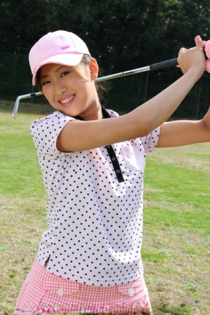 Young Japanese golfer Nao Yuzumiya flashes a no panty up skirt on the course