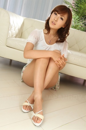 Japanese redhead Fujii cups her firm breasts during solo action