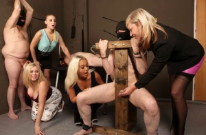 Clothed women jerk and tug on the tiny dicks of restrained male subs