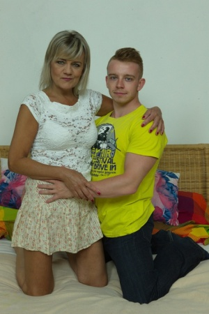 Blonde oma and her toy boy kiss before he strips her and eats her pussy