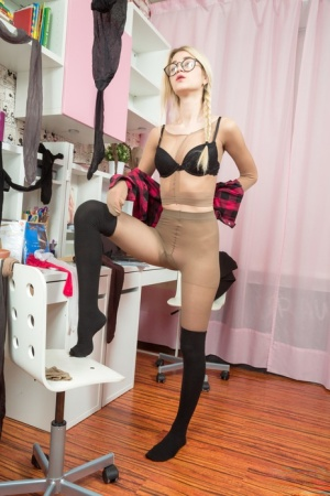 Nerdy blonde removes her glasses before covering her head in pantyhose