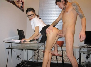 Amateur girl Dasha dons glasses during the making of a homemade porno