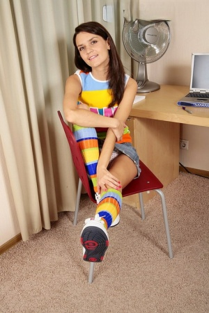 Solo girl Dasha gets naked in multi-colored knee socks and sneakers