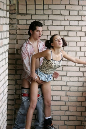 Cute teen Nadya gets fucked in the ass by a stranger on apartment balcony