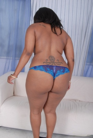 Ebony plumper shows the pink of her pussy after getting totally naked 96963369