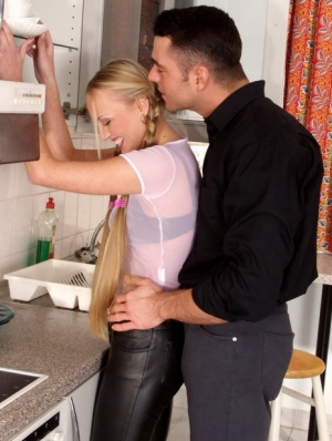 Young girlfriend in pigtails gets ass fucked naked on the kitchen counter