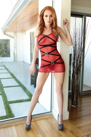 Hot redhead Jenny Blighe hikes up a sheer dress before banging a big dick