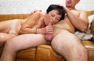 Naked oma sucks off her toy boy after a hard fuck on leather sofa