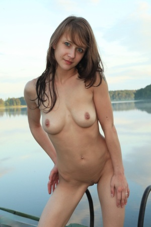 Teen first timer Veronika strips naked on a dock during cottage season